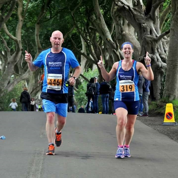 Roy White and Pamela Kane run through the iconic Dark Hedges