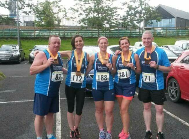Aidy Dodds, Vicki Dunn, Pamela Kane, Sharon Speers and Paul Cupples proudly display their medals after the Cookstown Half