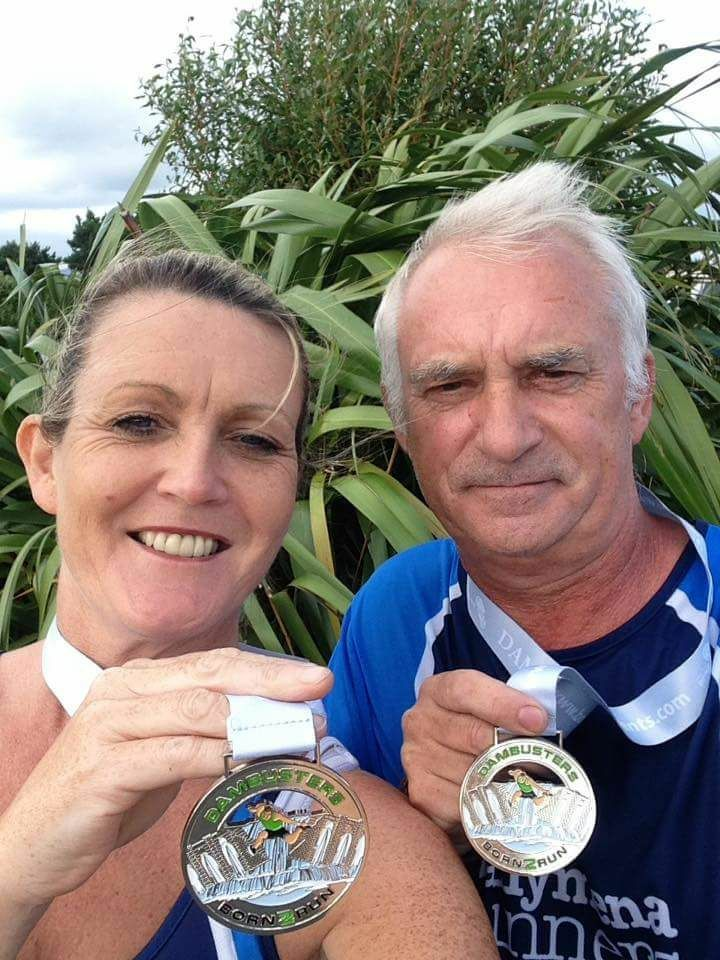 Sharon and Norman Stephens display their medals from the Dambusters 10k.jpg