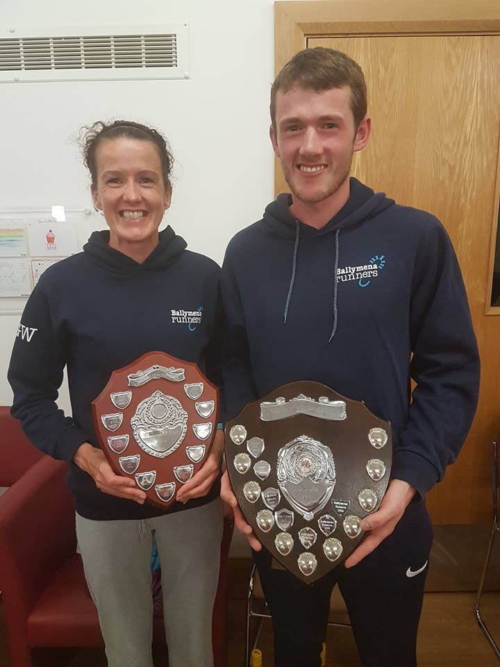 Gillian Wasson and James Hamilton display the Inter-Club Ladies and Men's Team Shields