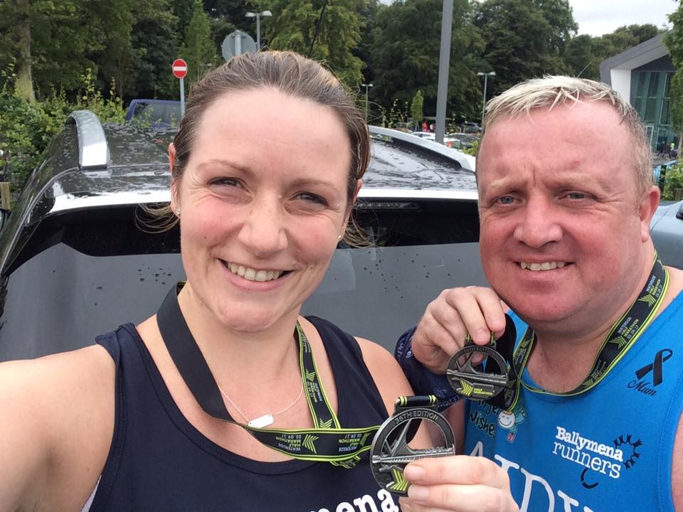 Lynsey McKeown and Adrian Dodds with their medals after completing the Waterside Half Marathon