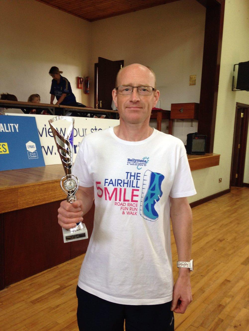 James Turtle displays his Rasharkin 5k trophy