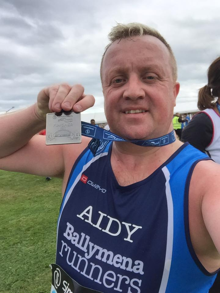 ... and with his Great North Run medal!