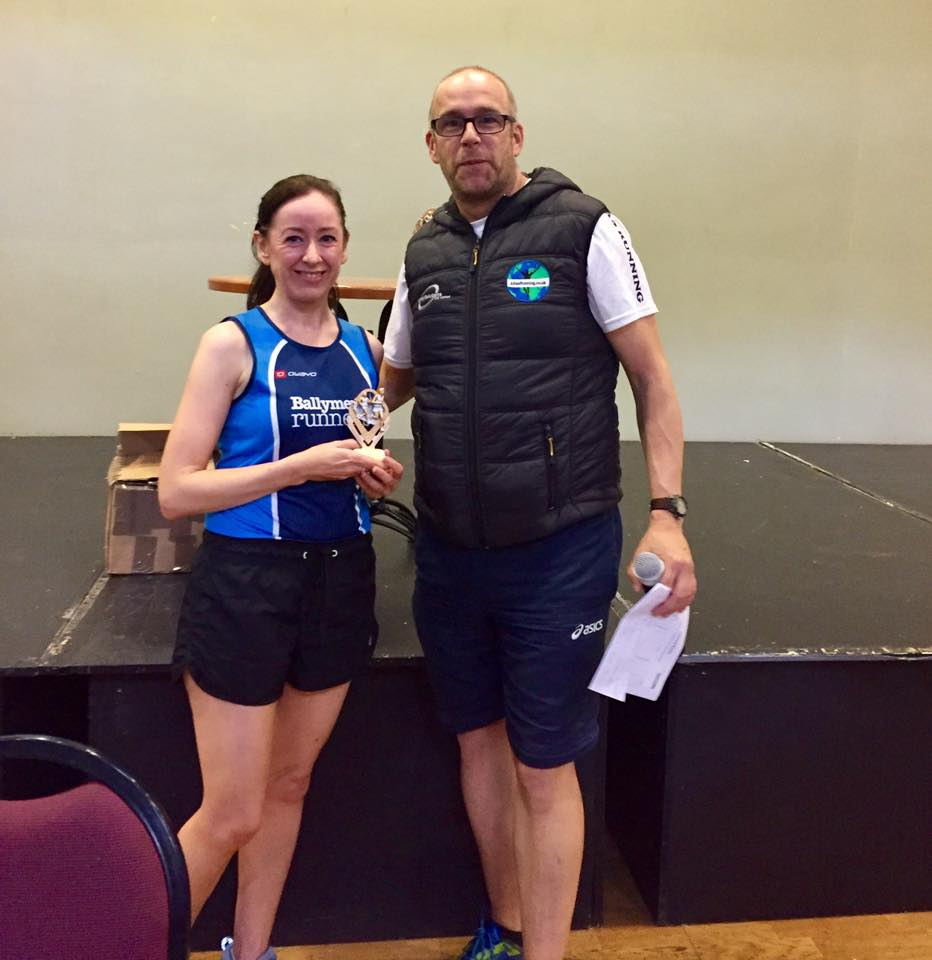 Sinead Scullion collects her prize for finishing third at the ALPS 10k