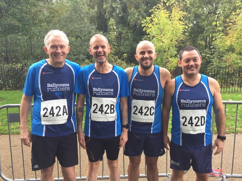 Robin Alexander, John Robinson, Chris Young and Alastair Donaghy form a very orderly queue at the NI Road Relay Championships!