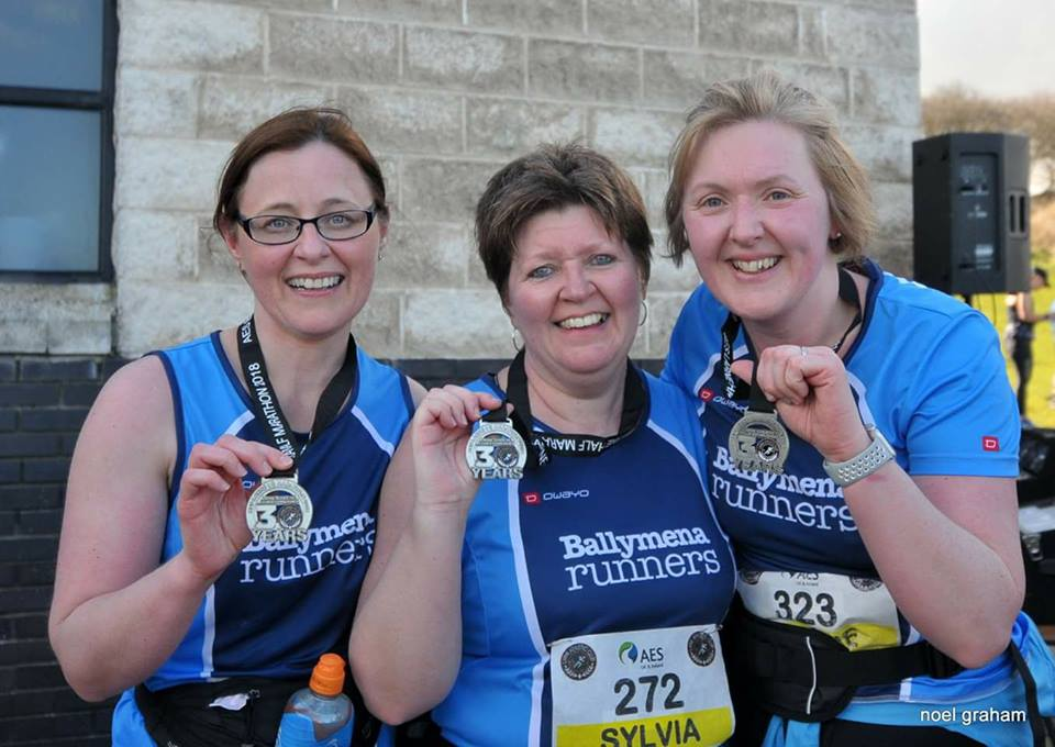 Helena Moore, Sylvia Ringer and Janine Redmond display their Larne Half Marathon medals