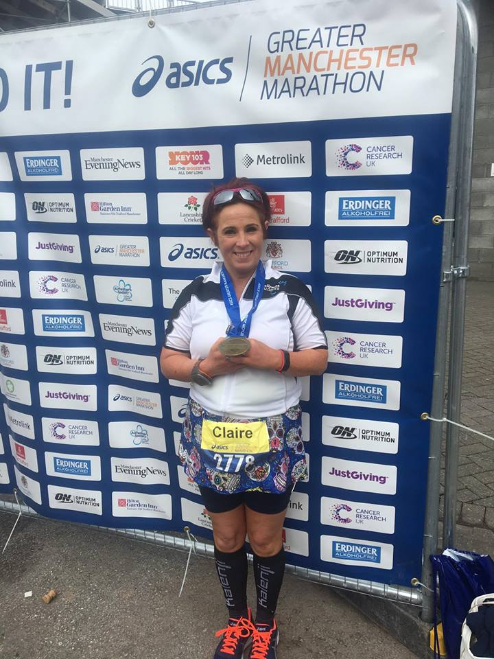 Claire Martin proudly displays her medal after a successful Manchester Marathon