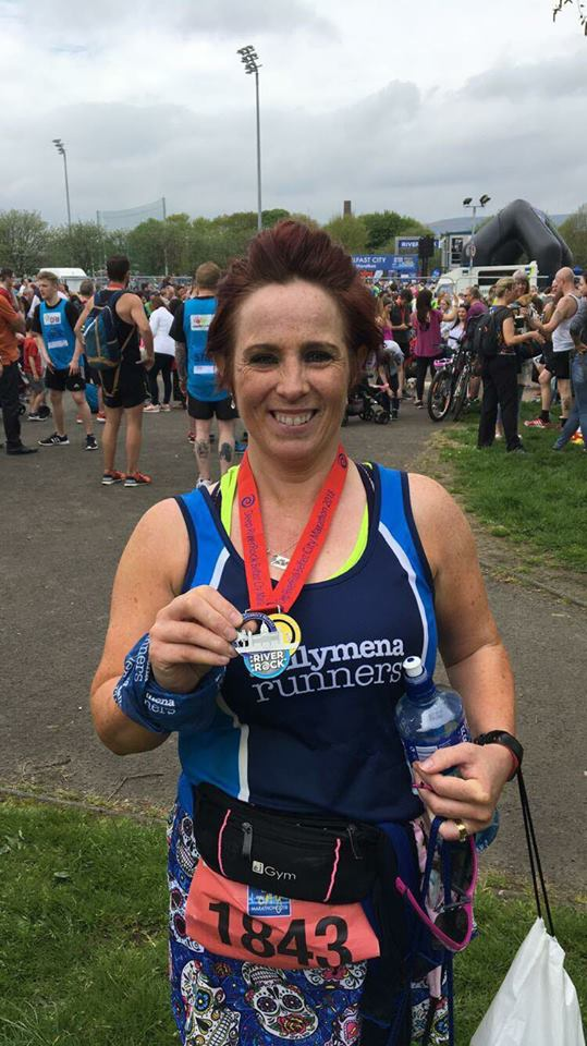 Claire Martin proudly displays her Belfast City Marathon medal