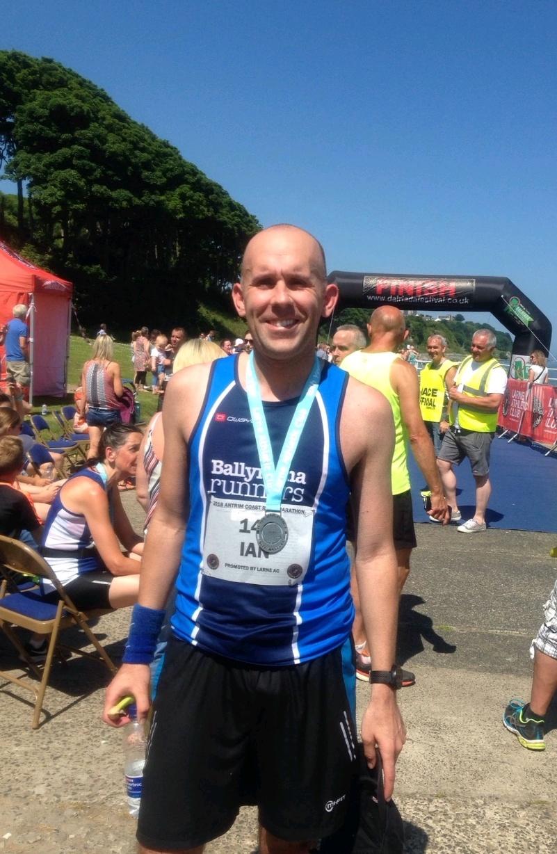 Ian McCracken celebrates his personal best at the Antrim Coast Road Marathon