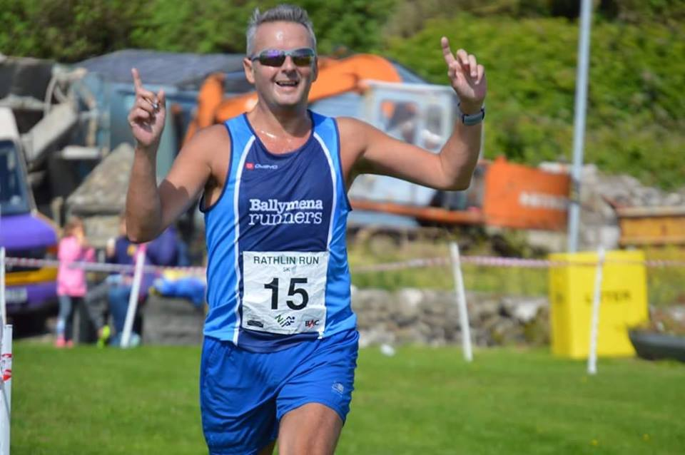 Peter Fleming celebrates winning the Rathlin Run 5k