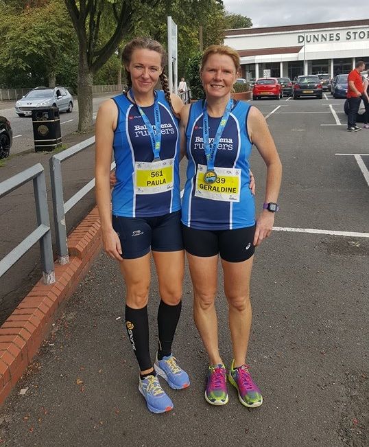 Paula Worthington and Gerardline Quigley display their Laganside 10k medals