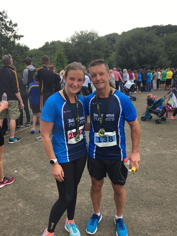 Naomi Hutchinson and Hugo Carlin at the end of the Waterside Half Marathon