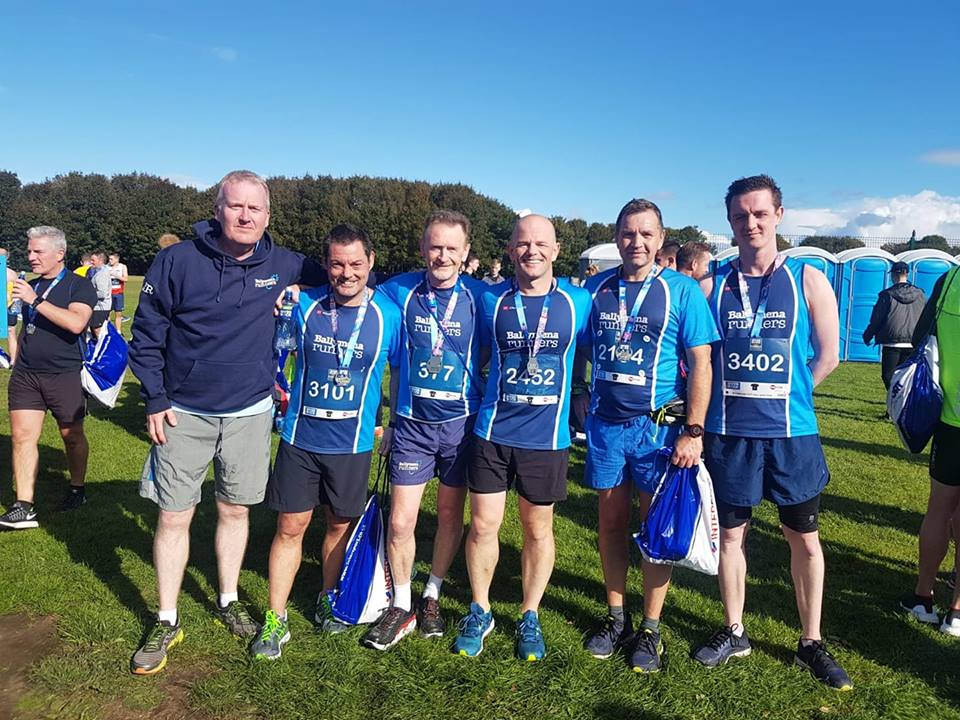 Eugene Reid, Alastair Donaghy, David Rainey, Chris Davies, Nigel Davidson and Conor Crilly after the Belfast Half Marathon