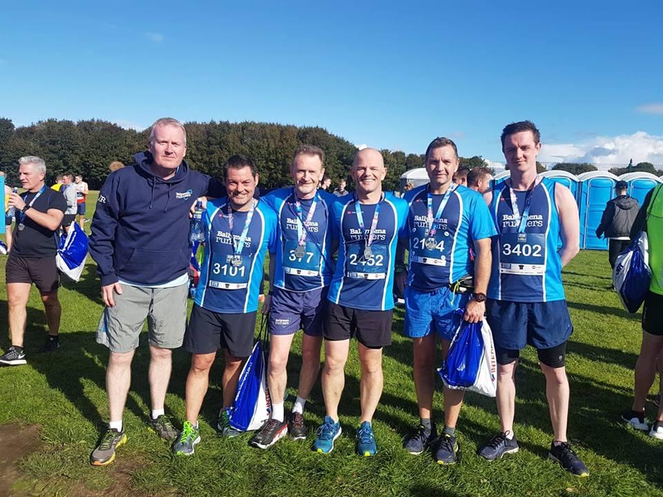 Eugene Reid, Alastair Donaghy, David Rainey, Chris Davies, Nigel Davidson and Conor Crilly after the Belfast Half Marathon