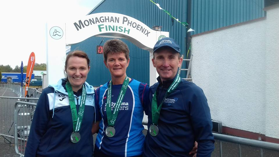 Kathryn Grant, Linda Petticrew and Rodney Agnew display their medals from the Monaghan Half Marathon