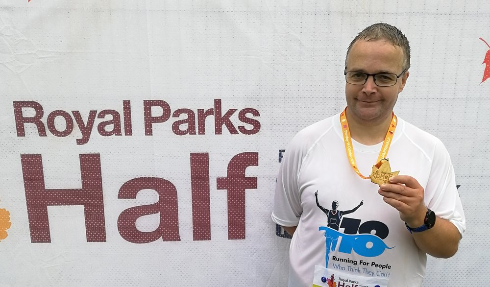 Martin Harris displays his medal from the Royal Parks Half Marathon, the concluding race in his challenge to run 18 half marathons in 2018