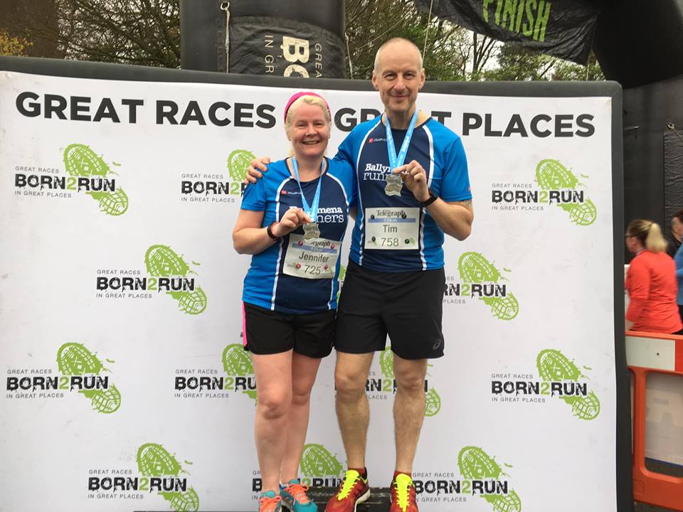 Jennifer Dickson and Tim Hawksworth display their Drum Manor 10k medals