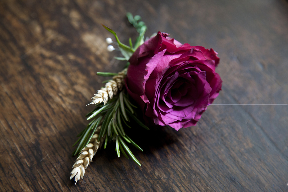 Purple rose buttonhole P&C.jpg