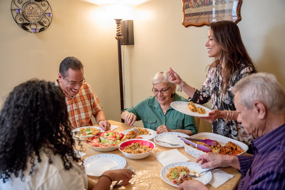 Nilda and family enjoying a meal