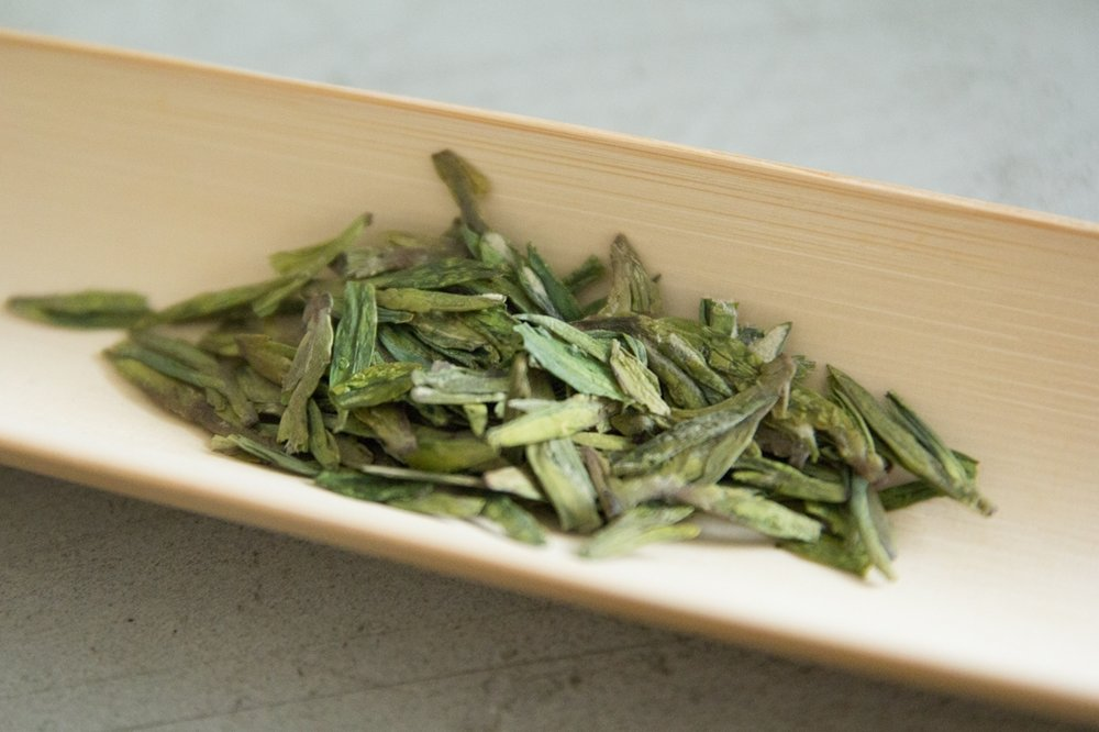Beautiful long blades of Longjing (Dragon's Well) tea leaves – a varietal of green teas.