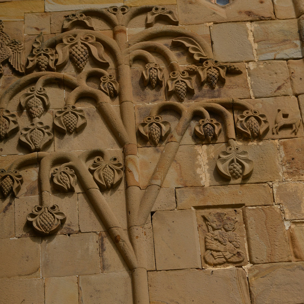 Bold relief carving on the exterior of the church at Ananuri in Georgia
