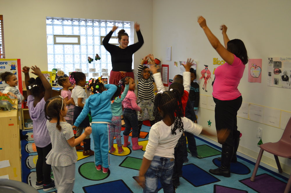 Detroit Wolf Trap Teaching Artist Rachel McIntosh working with Emmanuel Head Start students.