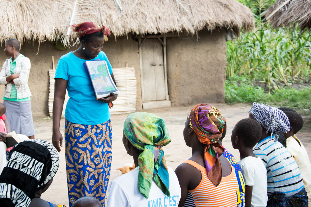Sharing Bible passages in a village near her church. Abra teaches these women about the Bible every Sunday afternoon after church ends.