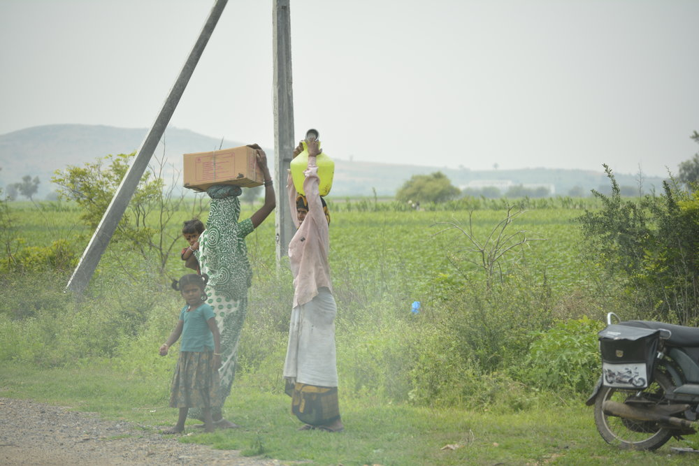 """Sometimes families are forced to walk great distances to retrieve water because the wells in their villages are for """"higher social classes"""" of people."""