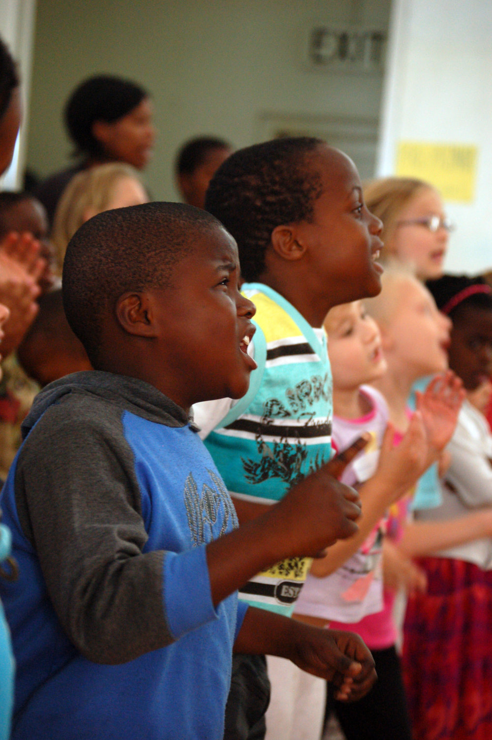 Children in DubSouth Africa worship God through singing during Holiday Bible Club.