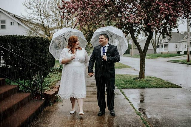 Sometimes you plan your entire day around the best light, and then Mother Nature decides to be uncooperative. Sometimes it rains copious amounts on your wedding day. And sometimes, if you're doing it right, you laugh it off and go with it because you're too busy being happy to even mind the rain.
