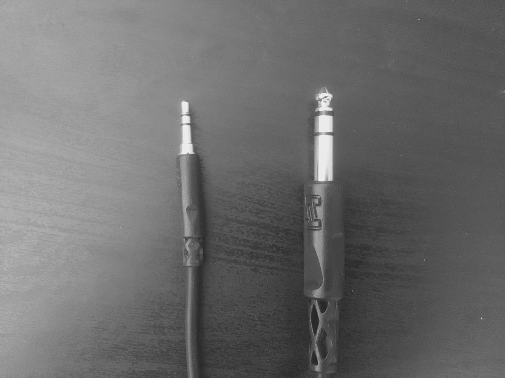 "Get a 1/8"" to 1/4"" cable - one end plugs into your device, and the other end plugs into a direct box."