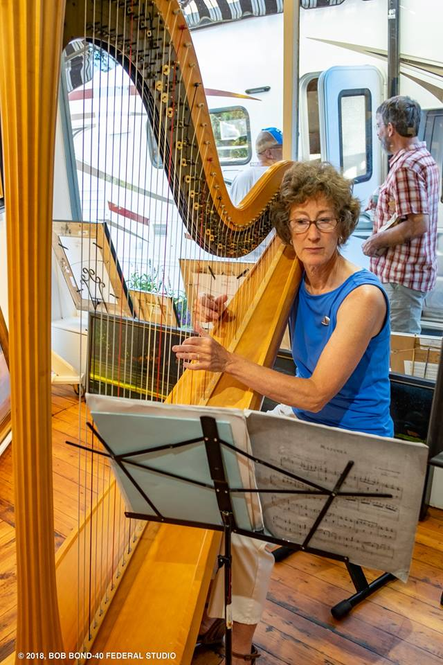 Suki Flanagan plays harp in Sylvan Gallery during the August 2018 Wiscasset Art Walk. (Bob Bond photo)