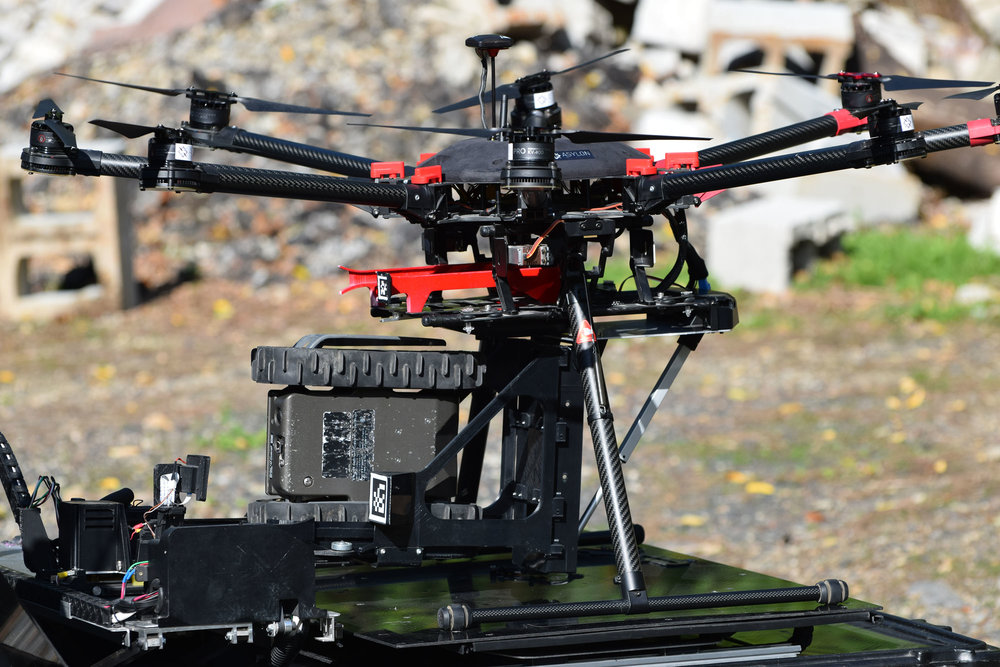 DroneHome station loading an Endeavor FirstLook onto a drone.