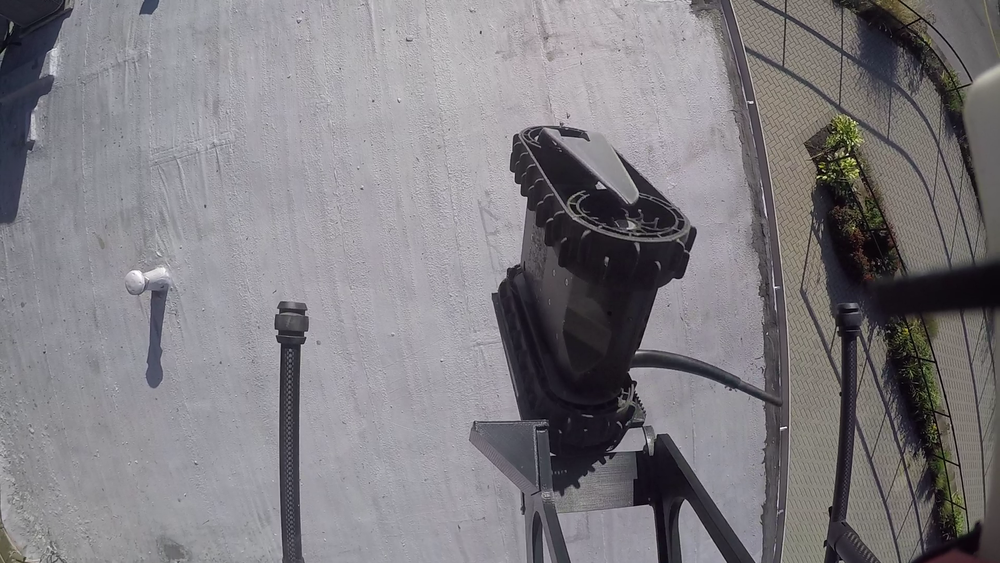 Drone dropping the FirstLook UGV onto a roof in Philadelphia, PA