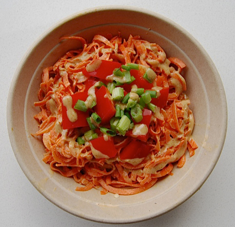MJ's raw pad thai. Carrot noddles tossed in an almond lime dressing. topped with red bell pepper, green onions and almonds.
