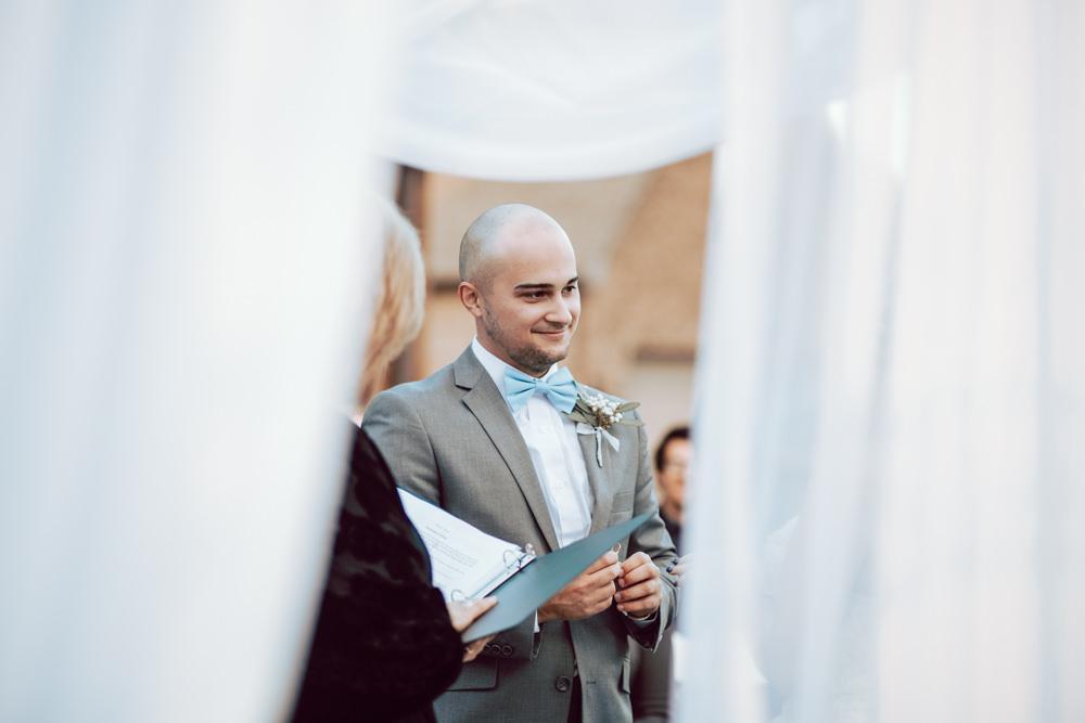 groom ring exchange curtains wedding