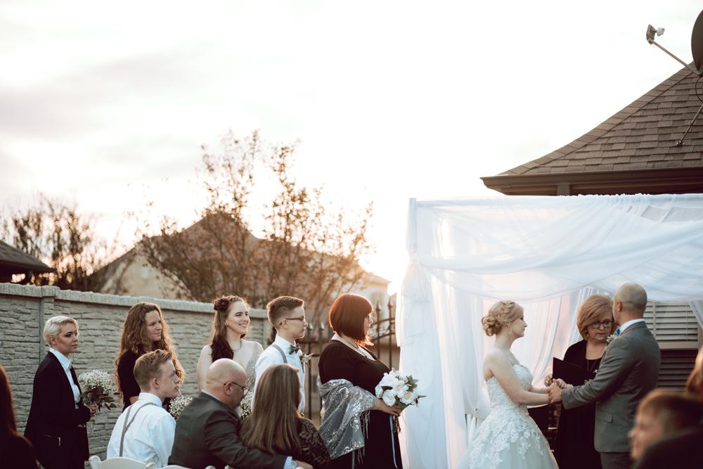 bridal party sunset backyard wedding