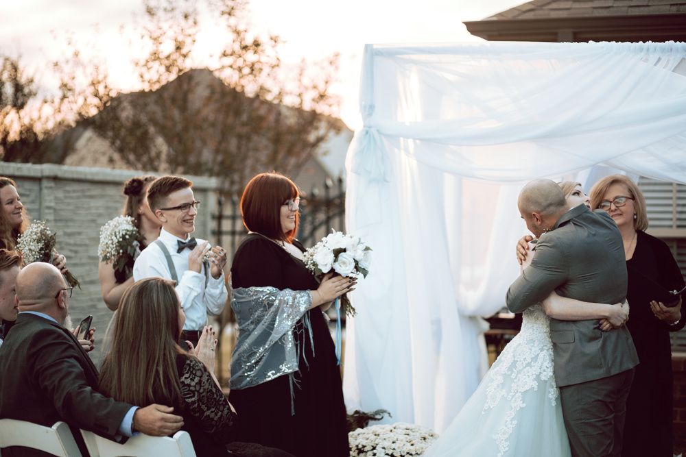 bride and groom hug ceremony