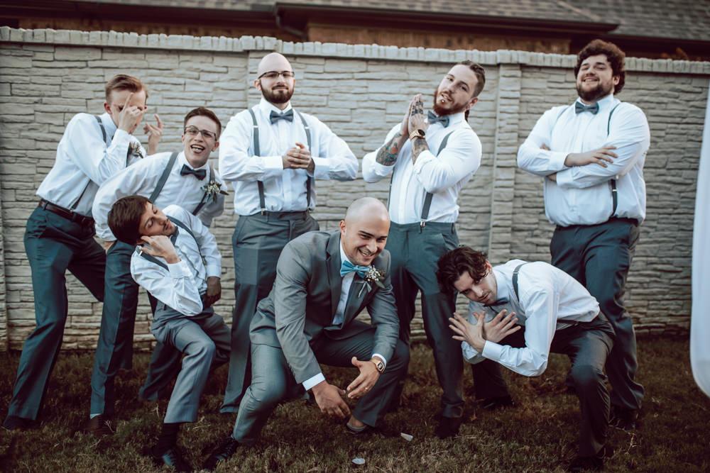 groom and groomsmen post up portrait