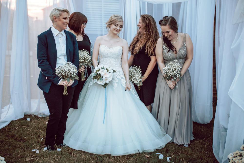 bride and bridesmaids laughter portrait