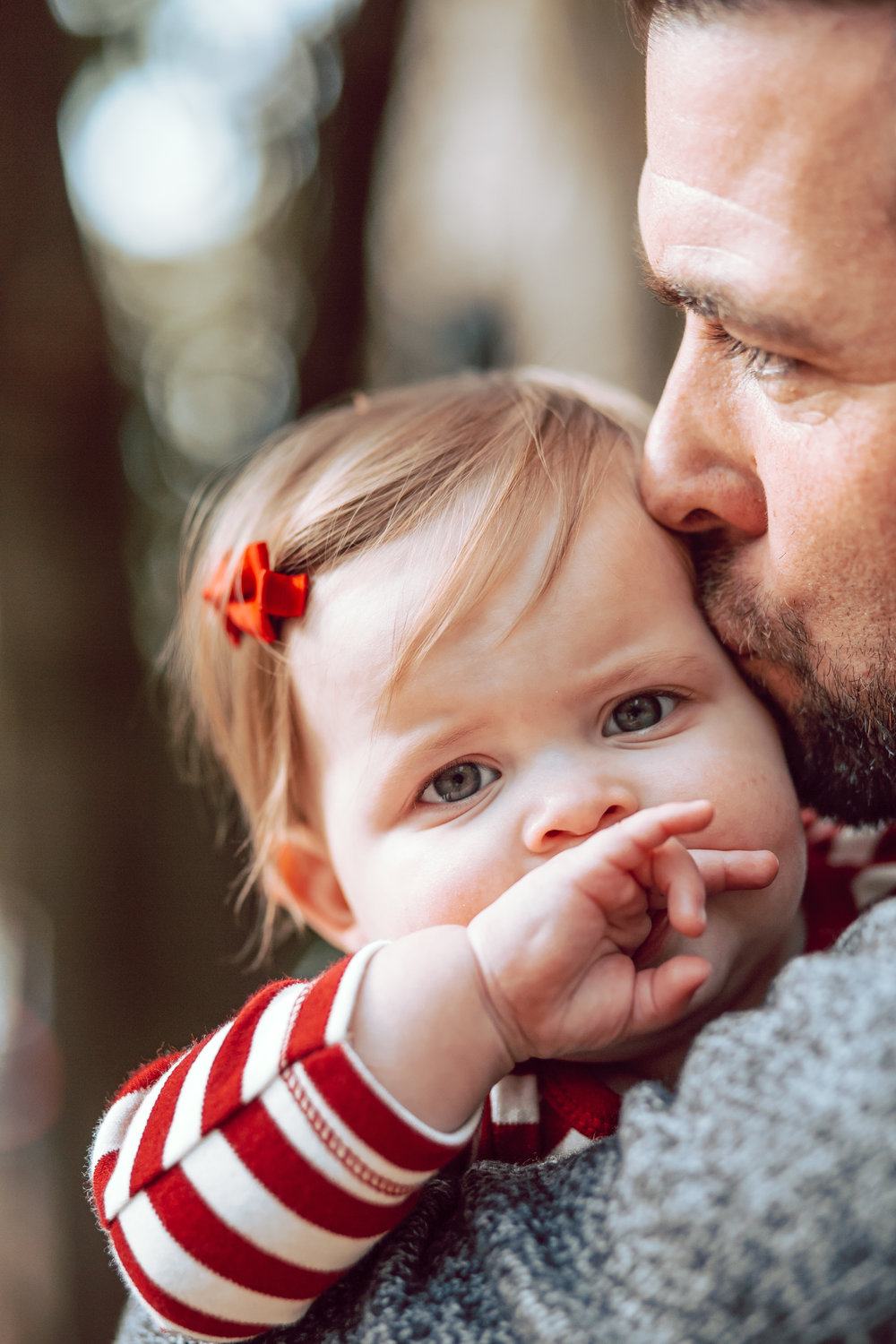 little girl eyes dad kissing cheek memphis