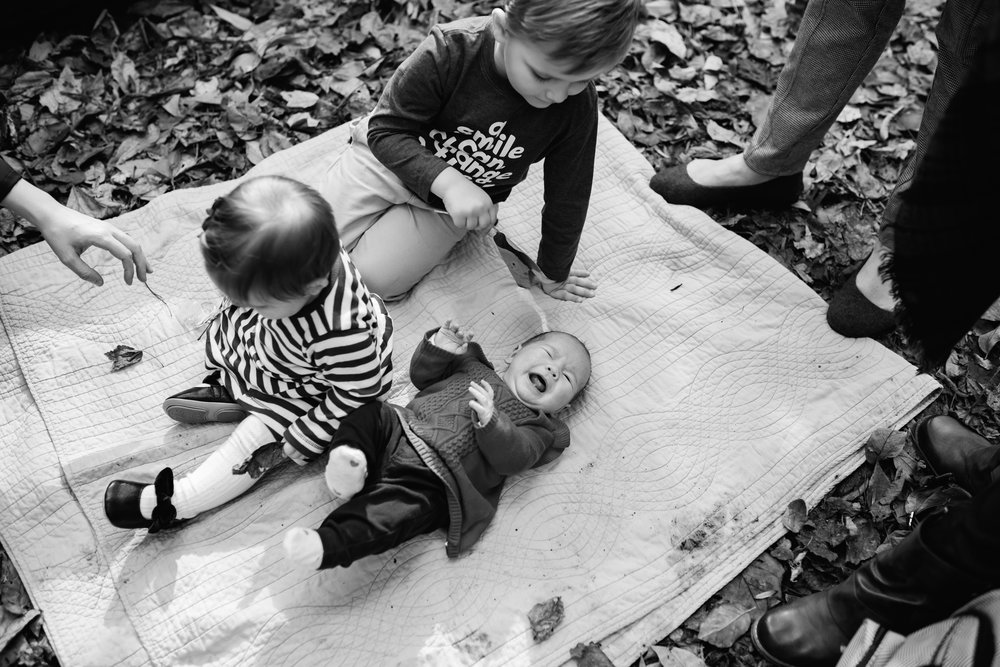 black and white cousins on blanket in overton park fall