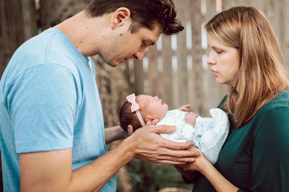 """Mother """"shh"""" to newborn baby in Midtown Memphis, TN."""