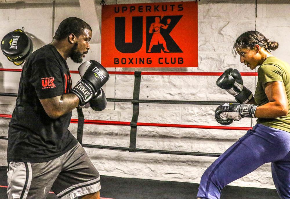 Jai training with UpperKuts Boxing coach, AJ Thomas.