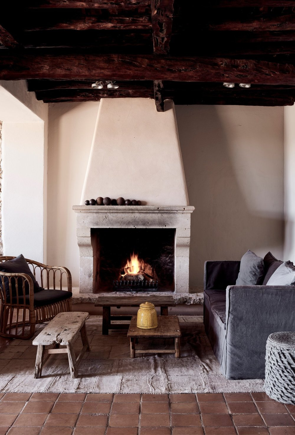 la-granja-ibiza-design-interior-living-room-fireplace-cosy.jpg