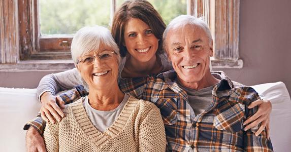 family-posing-for-portrait-on-couch-seniors-daughter_573x300.jpg