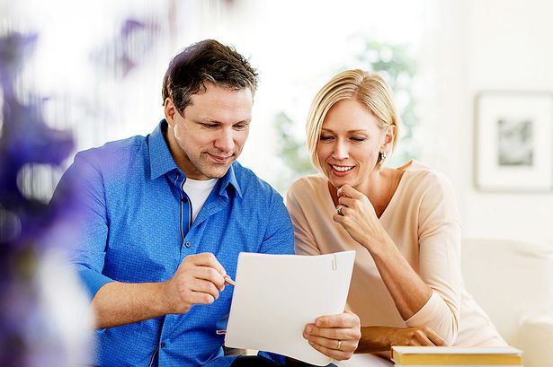 Couple-doing-paperwork-at-home.jpg