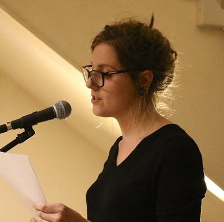 Performing a poem I wrote at a local regular Poetry Night in Peterborough
