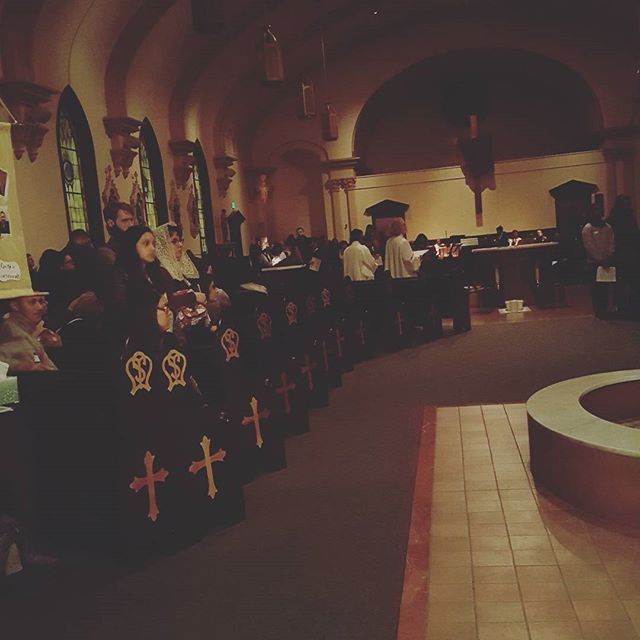 Bishop leading the pilgrimage in prayer at our first stop, St. Mary's #seattleyaholythursdaypilgrimage #seattlearchdiocese