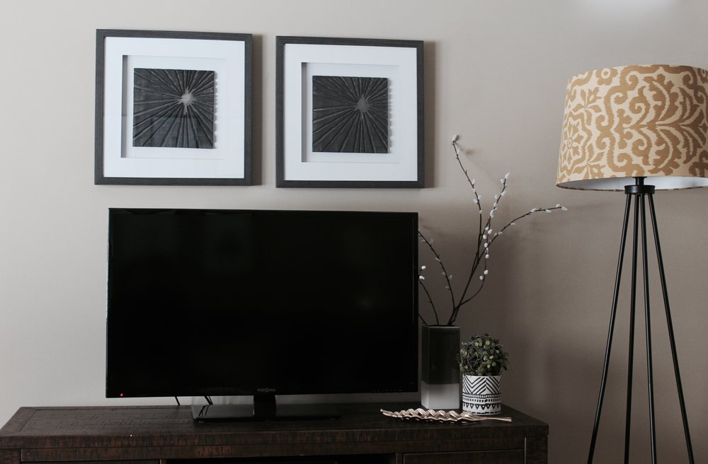 And yes, a TV wall can be pretty! This square art pair helps the TV blend in, and those whimsical branches make this area feel more natural and serene.